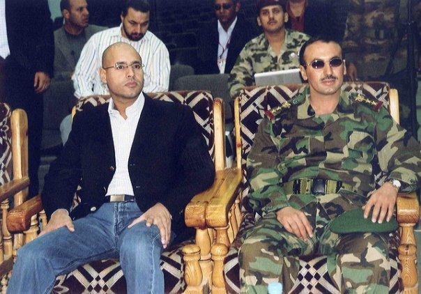 """صحيفة تكشف كيف نهبا """"ثنائي الاجرام"""" (نجل المخلوع ونجل القذافي) اموال الشعب"""