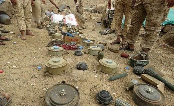 شاهد بالصور كيف كشفت سيول الأمطار عن عشرات الألغام والجثث التابعة لمليشيا الحوثي بصرواح