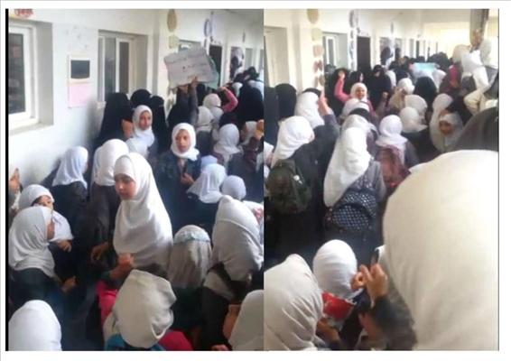 إحتجاجا على محاولات التغيير.. طالبات في المحويت يرمين مشرفي الحوثي بالحجارة